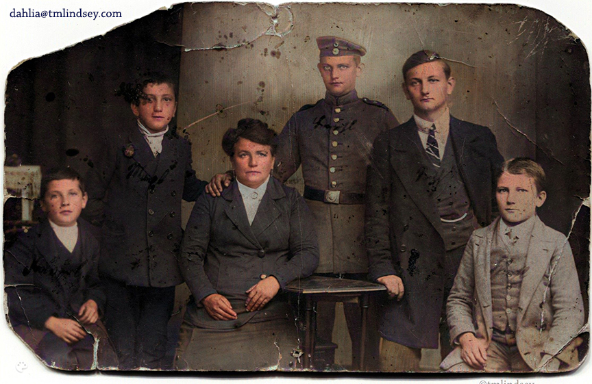 Photo of Theresa Brummer and five of her sons. Center back is Norbert Schiessl in uniform.